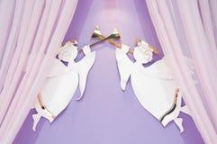 Interior of honeymoon room. Luxury interior of honeymoon room in hotel. Two angels with horn Stock Photography