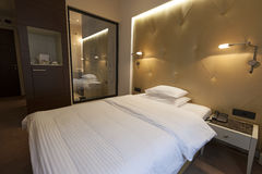 Interior of a hotel bedroom in the evening Royalty Free Stock Photography