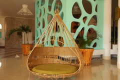 Interior of the hotel in the Caribbean, swing from rattan royalty free stock photos