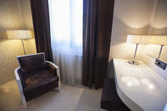 Interior of a hotel room with armchair Stock Images