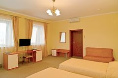 Interior of the hotel room in warm colors. Modern classics.  stock images