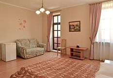 An interior of the hotel rr of the hotel room in pink tones with an exit to a balcony. Modern classics. An interior of the hotel room in pink tones with an exit royalty free stock image