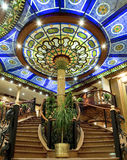 Interior hotel stairway. Interior curved stairways below a colorful stained glass atrium in a hotel lobby in Egypt Royalty Free Stock Photos