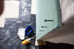 Interior house alterations works Drywall. Construction worker holding the hand drill electric screwdriver Stock Photos