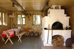 Interior house with oven. Interior of russian house with traditional oven Stock Photos