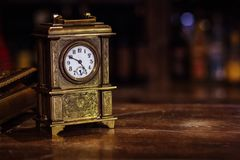 Antique clock stand on a wooden table stock images