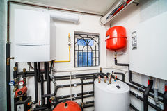 Interior household boiler with gas and electric boilers.  royalty free stock photography