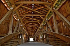 Interior of a huge covered bridge. The structure of age interior of a huge covered bridge is seen in the daylight Royalty Free Stock Photography