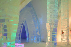 Interior ice hotel with colored light. Stock Photos
