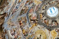 Interior of Il Duomo Cathedral. Florence, Italy, June 13, 2015: Interior of Il Duomo Cathedral, with magnificent art work on the ceiling, Florence, Italy stock photo