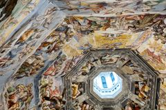Interior of Il Duomo Cathedral. Florence, Italy, June 13, 2015: Interior of Il Duomo Cathedral, with magnificent art work on the ceiling, Florence, Italy royalty free stock image