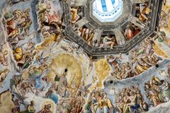 Interior of Il Duomo Cathedral. Florence, Italy, June 13, 2015: Interior of Il Duomo Cathedral, with magnificent art work on the ceiling, Florence, Italy royalty free stock images