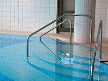 Interior of indoor swimming pool Royalty Free Stock Image