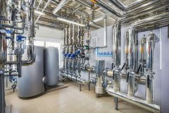 The interior of an industrial boiler house with a multitude of p royalty free stock photography