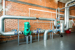 Interior of an industrial boiler with pipes and pumps Royalty Free Stock Images