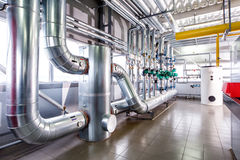 Interior of an industrial boiler, the piping, pumps and motors stock photo