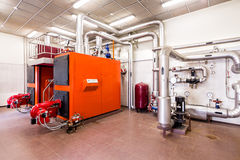 Interior industrial diesel boiler room with boilers and burners Stock Photo