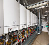 Interior of industrial, gas boiler house with a lot of boilers a. Nd equipment royalty free stock photos