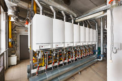 Interior of industrial, gas boiler house with a lot of boilers a. Nd equipment stock image