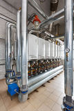Interior of industrial, gas boiler house with a lot of boilers a. Nd equipment stock photo