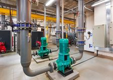 Interior of industrial, gas boiler room with boilers; pumps; sensors and a variety of pipelines.  stock image