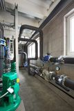 Interior of industrial, gas boiler room with boilers; pumps; sensors and a variety of pipelines.  royalty free stock photos