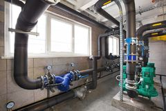 Interior of industrial, gas boiler room with boilers; pumps; sensors and a variety of pipelines.  royalty free stock photography