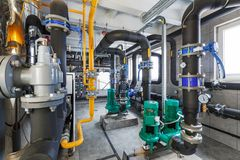 Interior of industrial, gas boiler room with boilers; pumps; sensors and a variety of pipelines.  stock images