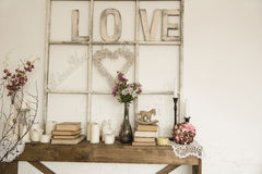 Interior with an inscription love, books, flowers and candles Stock Image