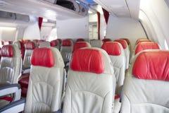Interior inside an airplane, seats Stock Photos