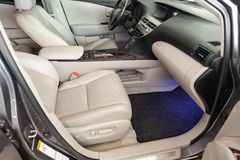 Interior inside the car: front passenger seat, overwhelmed with genuine beige leather, modern interior design with wood elements stock images