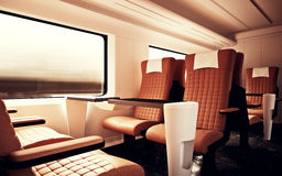 Interior Inside First Class Cabin Modern Speed Express Train.Empty Brown Chairs Window.Comfortable Seats and Table Stock Photography