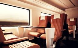 Interior Inside First Class Cabin Modern Speed Express Train.Empty Brown Chairs Window.Comfortable Seats and Table. Interior Inside First Class Cabin Modern Stock Photography
