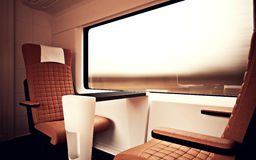 Interior Inside First Class Cabin Modern Speed Express Train.Nobody Brown Chairs Window.Comfort Seats and Table Business. Travel. 3D rendering.High Textured Row Royalty Free Stock Photography