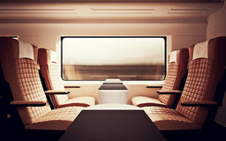 Interior Inside First Class Cabin Modern Speed Express Train.Nobody Brown Chairs Window.Comfortable Seat and Table. Business Travel. 3D rendering.High Textured Stock Photo
