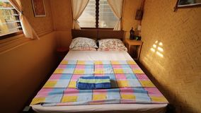 Interior inside an inexpensive room in a cheap hotel in Asian countries. In the room there is a double bed. Interior inside an inexpensive room in a cheap hotel stock footage