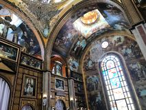 Interior inside the old orthodox Christian church in a Muslim Arab Islamic country with icons, prayers, god murals, ornaments, pa. Interior inside the old Royalty Free Stock Photos