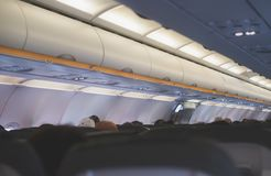 Interior inside of the plane. Interior inside of the plane with passengers Royalty Free Stock Photo