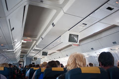 Interior inside of the plane with passengers. Royalty Free Stock Photo