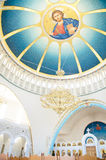 Interior inside view of dome with image of Jesus Christ in Cathedral of Resurrection,Tirana, Albania. Royalty Free Stock Image