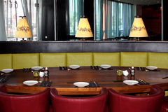 Interior of the Japanese restaurant. Oval table, armchairs and lamps with hieroglyphs Royalty Free Stock Images
