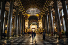 Interior of Kazan Cathedral with people. Kazan Cathedral is one of the largest churches in St. Petersburg. Saint Petersburg, RUSSIA - MAY 30, 2017: Interior of Royalty Free Stock Photos