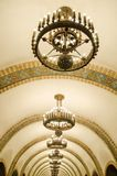 Arched ceiling of the subway interior in Kiev. Interior of the Kiev subway, decorative ceiling, arched arch with large chandeliers, perspective Royalty Free Stock Images