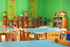 Interior of kindergarten. Chairs, table and toys. Interior of kindergarten royalty free stock images