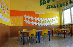 Interior kindergarten classroom with chairs and table Stock Image