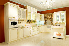 Interior kitchen. Interior of a table room in in classical style with a kind on kitchen and a bar rack Stock Photo