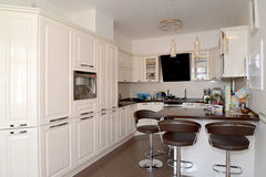 Interior of a kitchen-dining room in light tones Royalty Free Stock Photos