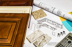 Interior kitchen renovation planning. New construction of interior kitchen renovation, design, doors, floor tiles and counters Stock Photography