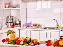 Interior of kitchen with vegetables Stock Photos