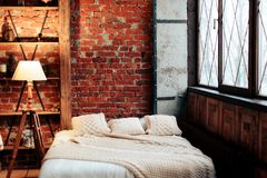 Interior with a large bed and a brick wall royalty free stock images